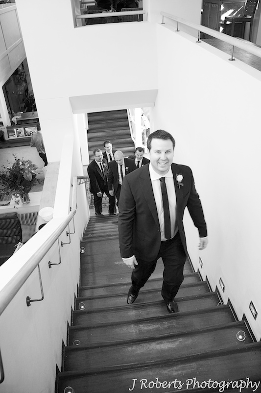 Groom walking up to ceremony on Bathers Pavilion Terrace - wedding photography sydney