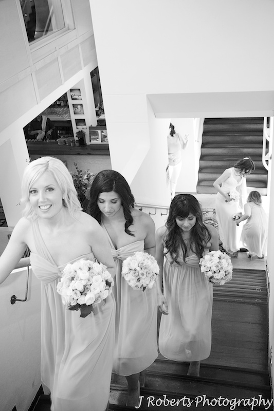 Bride and bridesmaid coming up the stairs for ceremony - wedding photography sydney
