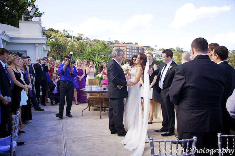 Bride being handed over to the groom by her father - wedding photography sydney