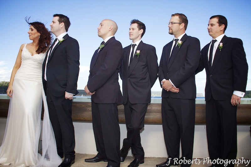 Couple and groomsmen during wedding ceremony - wedding photography sydney