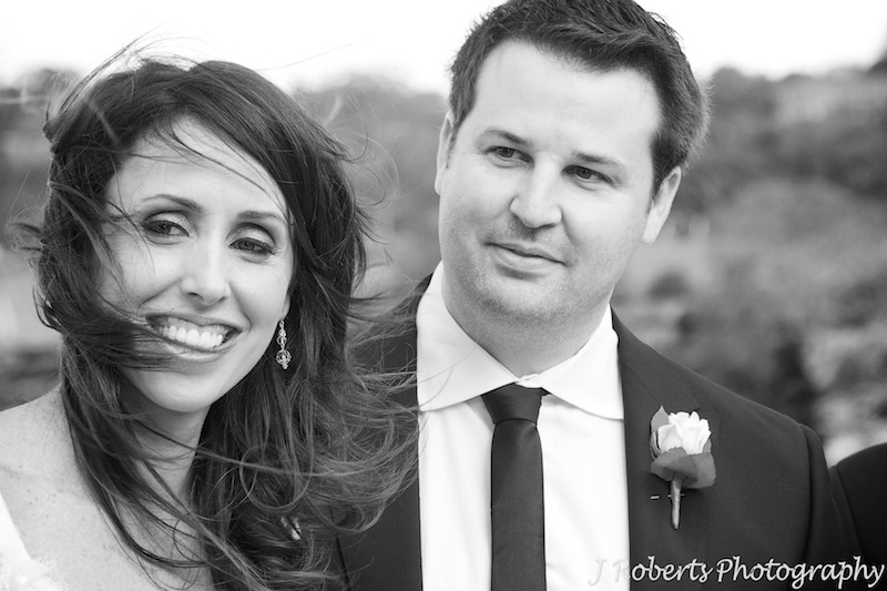 Bride and groom all smiles during wedding ceremony - wedding photography sydney