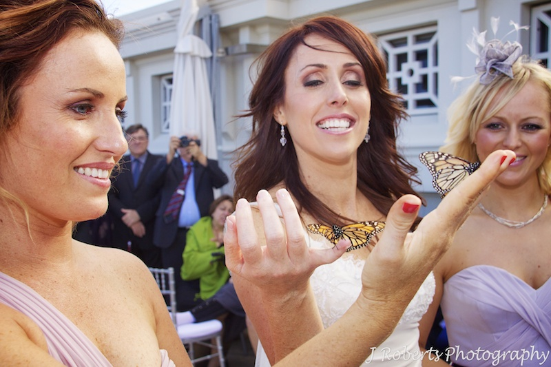 Butterflies on brides fingers during butterfly release - wedding photography sydney