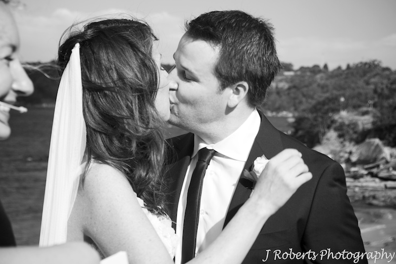 Bride and grooms first kiss on Bathers Pavilion Terrace Balmoral - wedding photography sydney