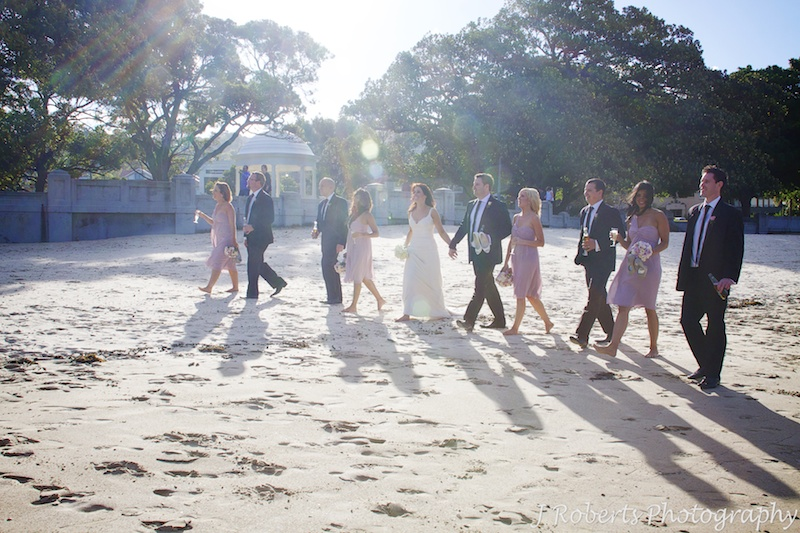 Bridal party walking along Balmoral Beach - wedding photography sydney