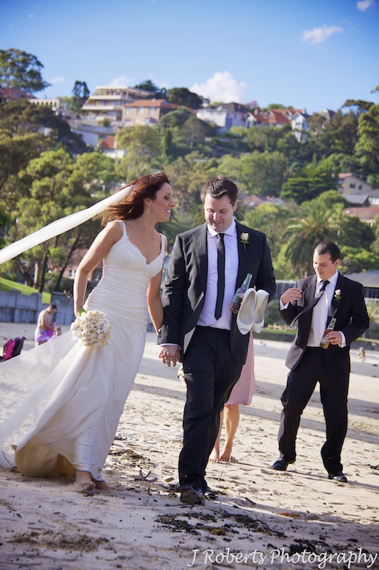 Bride and groom walking along Balmoral Beach - wedding photogrpahy sydney
