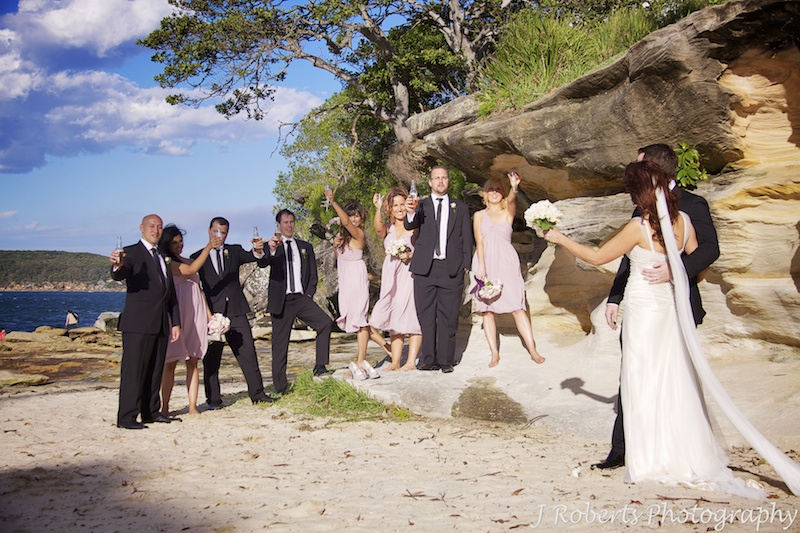 Cheers from the bridal party at Balmoral Beach - wedding photography sydney