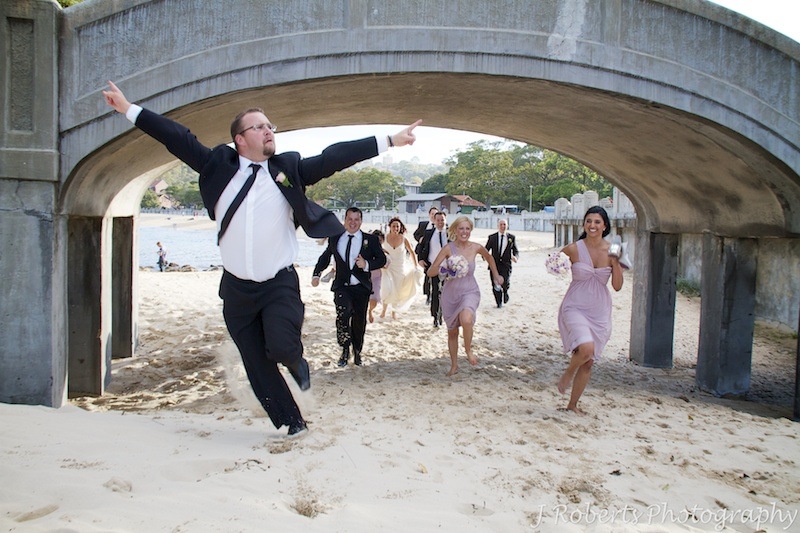 Groomsman celebrating race win - wedding photography sydney