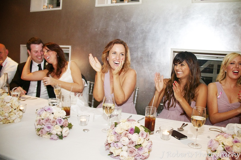 Bridesmaids laughing at wedding speeches - wedding photography sydney
