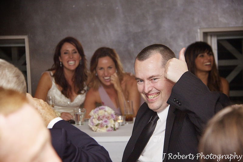 Brother of bride laughing at wedding speeches - wedding photography sydney