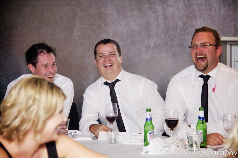 Groomsmen laughing at wedding speeches - wedding photography sydney