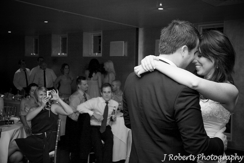 Couple embracing during the bridal waltz - wedding photography sydney