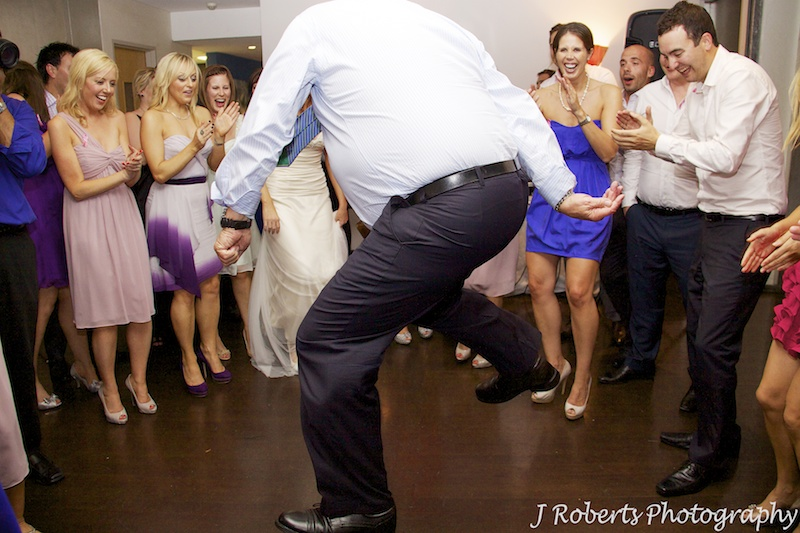 Older man dancing in the circle on the dance floor - wedding photography sydney