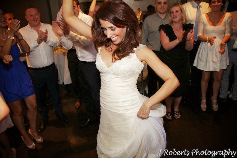 Bride into the action on the dance floor - wedding photography sydney
