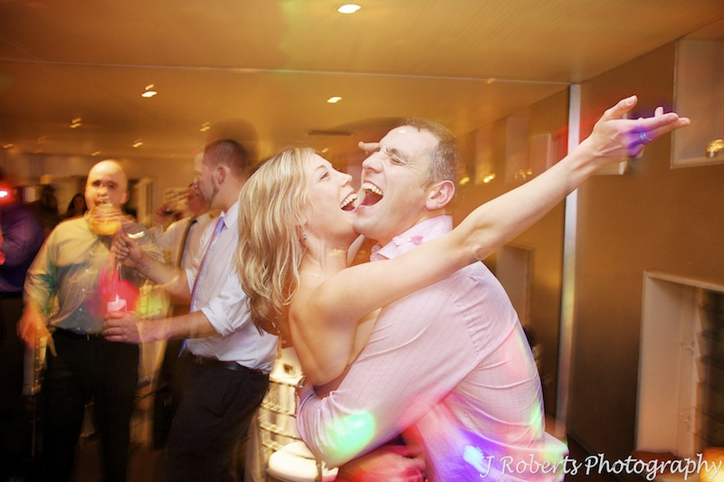 Couple singing while on the dance floor -wedding photography sydney