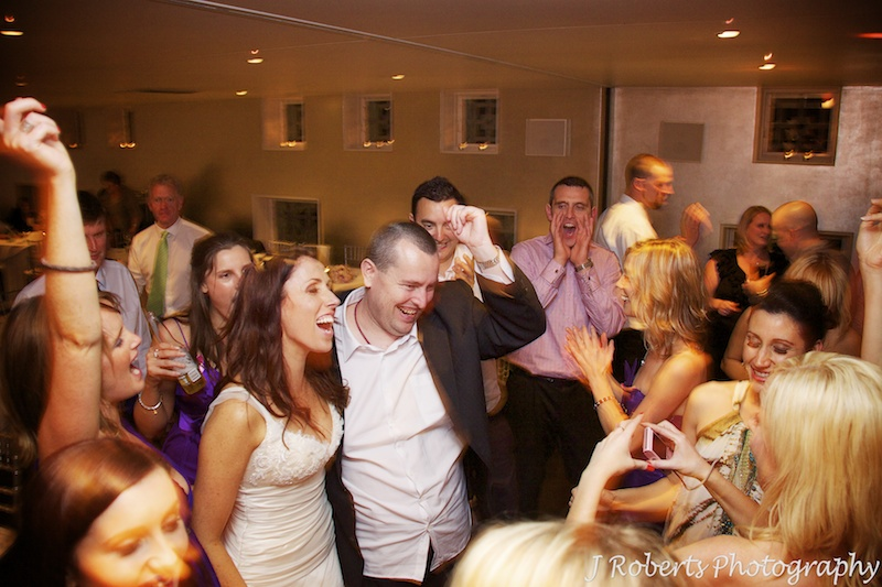 Bride and her brother on the dance floor = wedding photography sydney