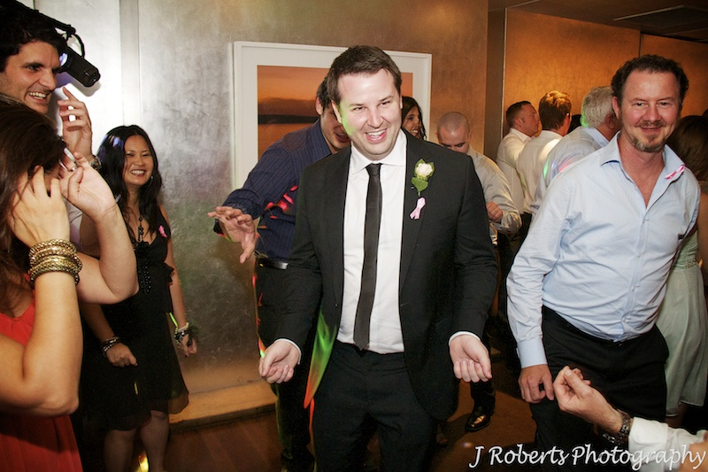 Groom on the dance floor = wedding photography sydney