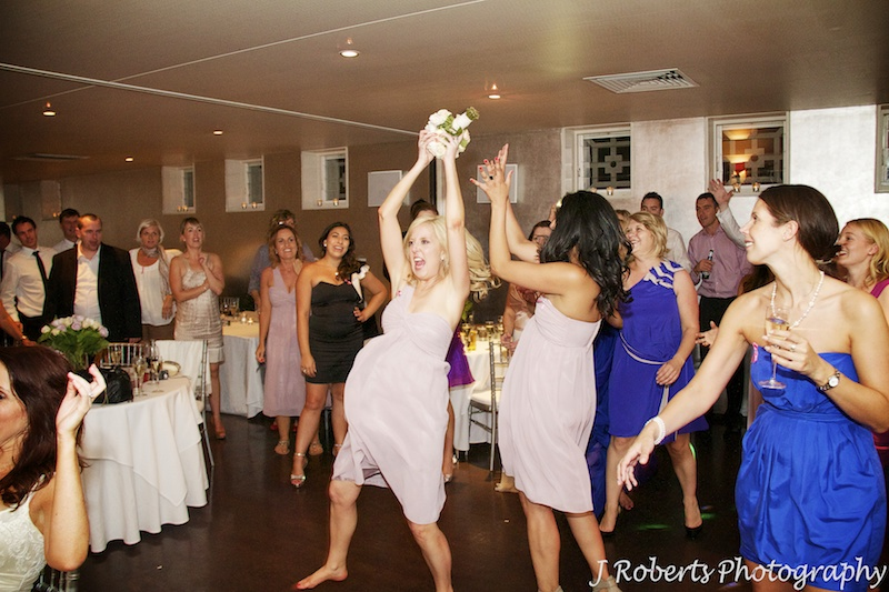 Bridesmaid catching the bouquet - wedding photography sydney