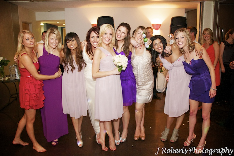 Bride with all the single girls after the bouquet throw - wedding photography sydney