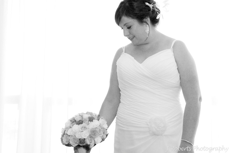 Bride looking at her bouquet - wedding photography sydney
