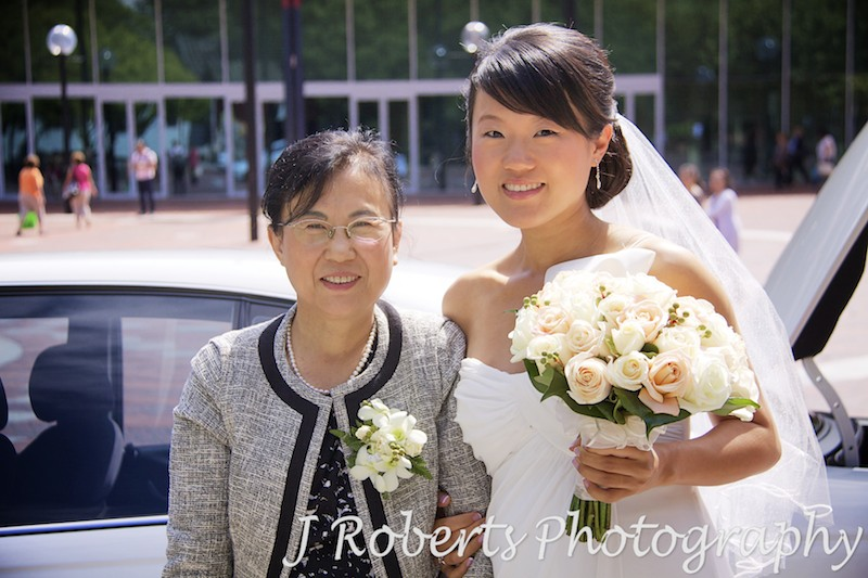 Bride and mother getting out of car at Chinese Gardens - wedding photography sydney