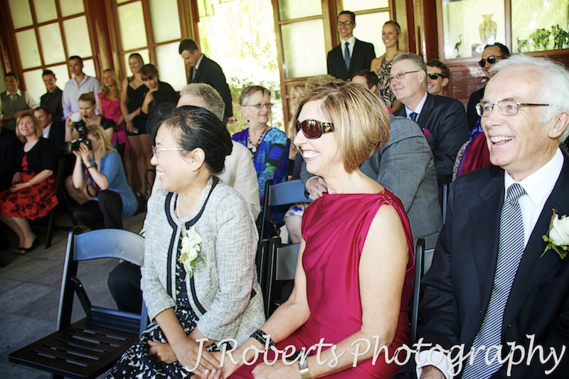 Family laughing during wedding ceremony - wedding photography sydney