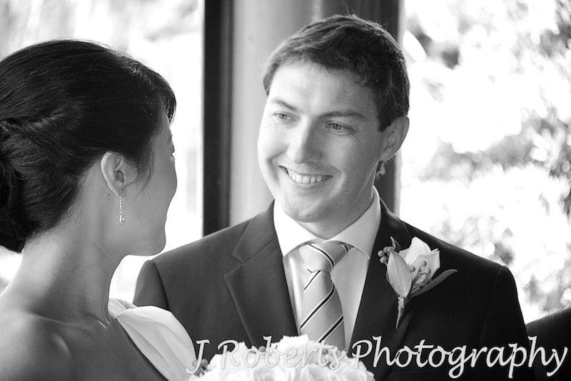 Groom smiling at bride during wedding ceremony - wedding photography sydney