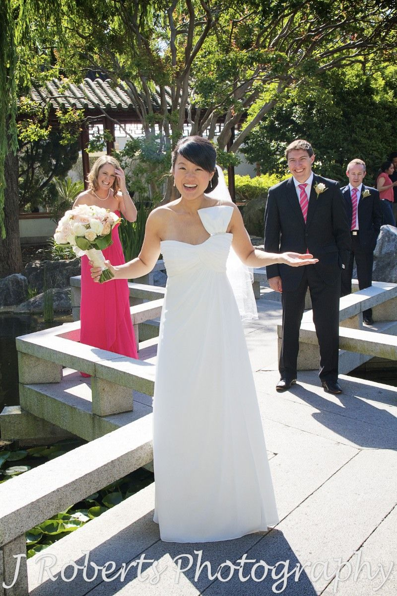 Bridal party laughing in chinese gardens sydney - wedding photography sydney