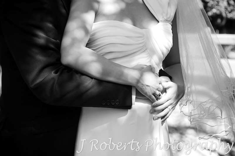 Bride and groom holding pregnant belly - wedding photography sydney