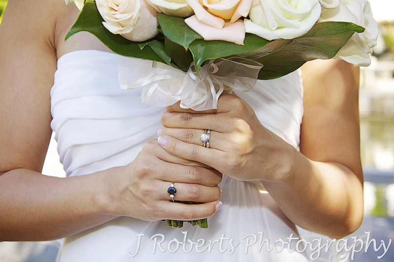 Bride holding bridal bouquet showing new wedding band - wedding photography sydney