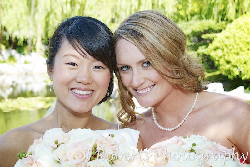 Bride and bridesmaid smiling at camera - wedding photography sydney