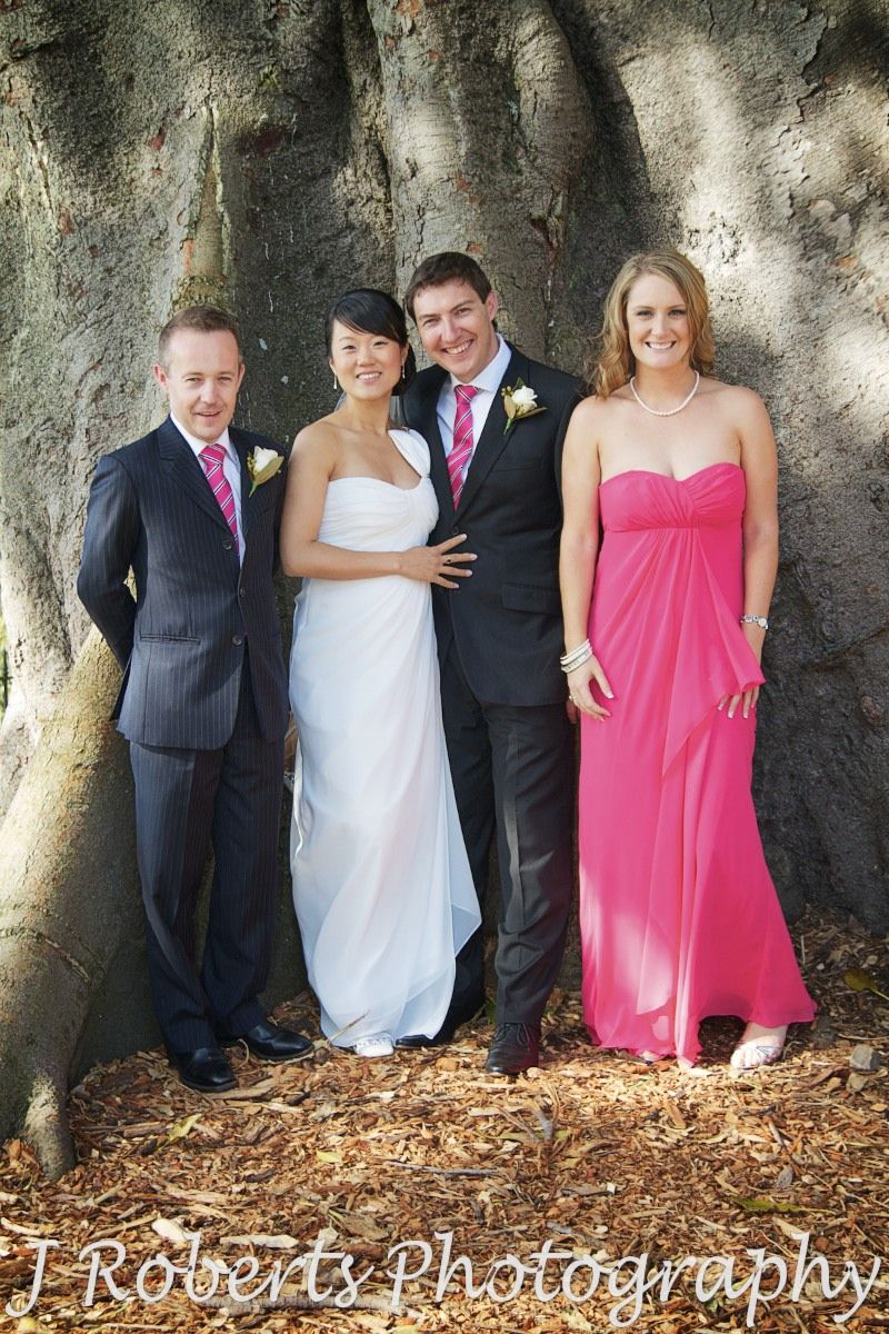 Bridal party under fig tree at Observatory Hill - wedding photography sydney
