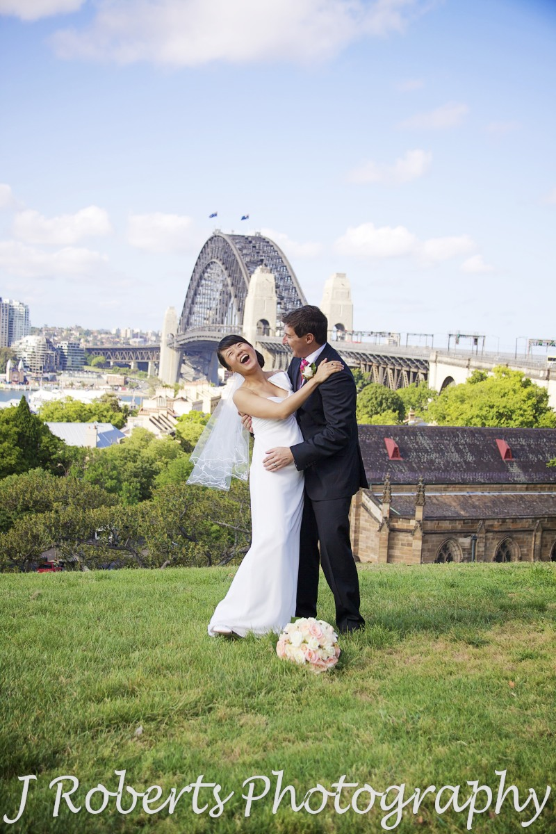 Couple in laughing embrace - wedding photography sydney
