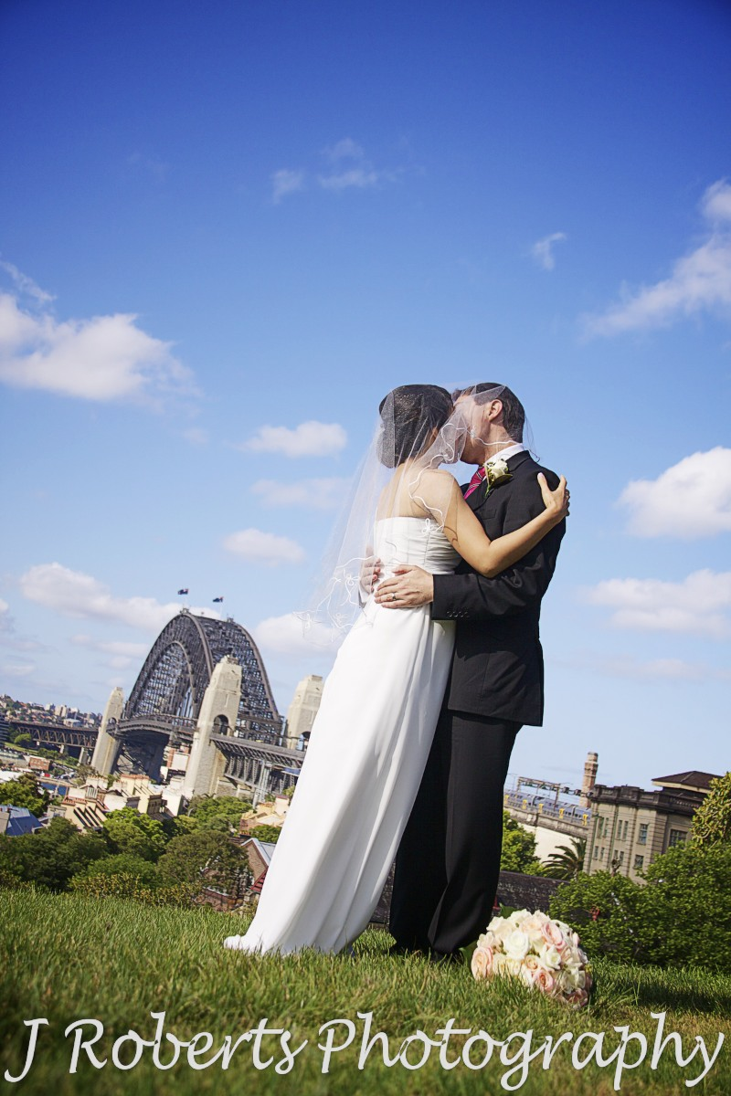 Couple kissing under veil observatory hill sydney - wedding photography sydney