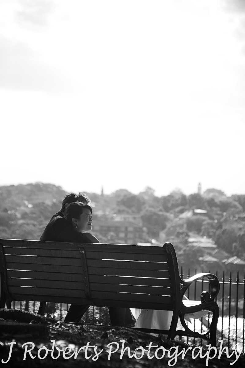 Couple enjoying the view from park bench observatory hill - wedding photography sydney