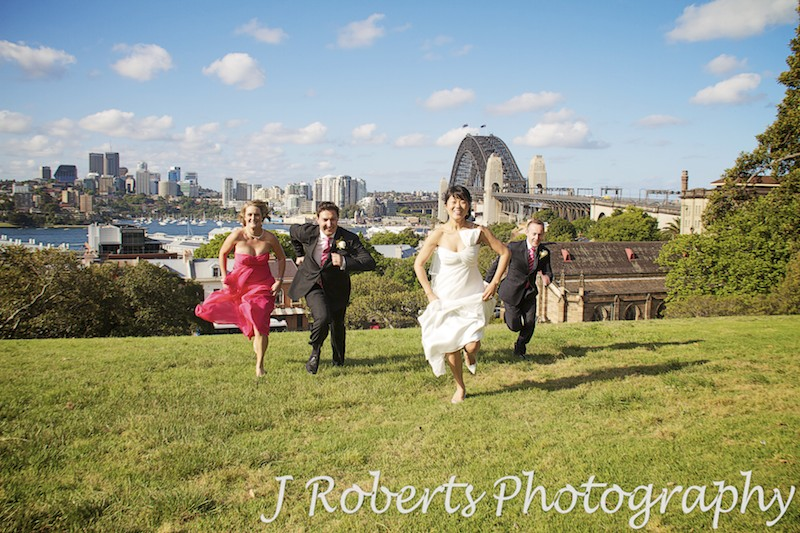 Bridal party running up observatory hill - wedding photography sydney