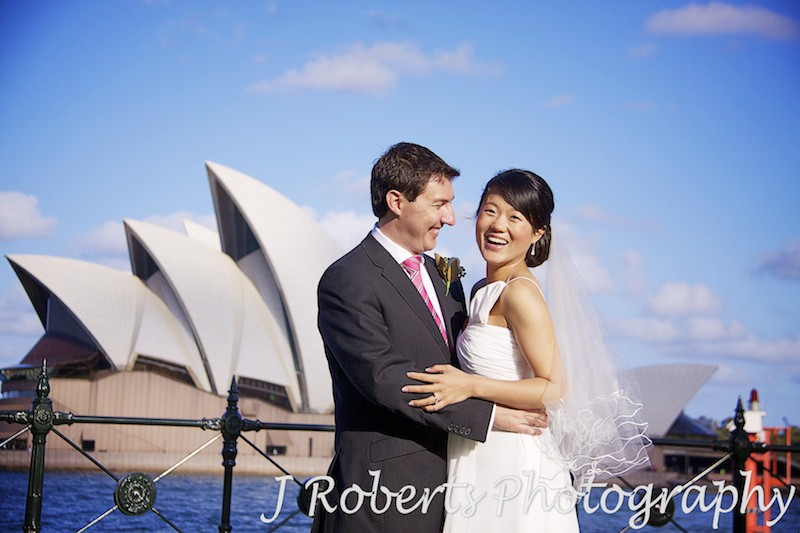 Couple in front of Sydney Opera House - wedding photography sydney