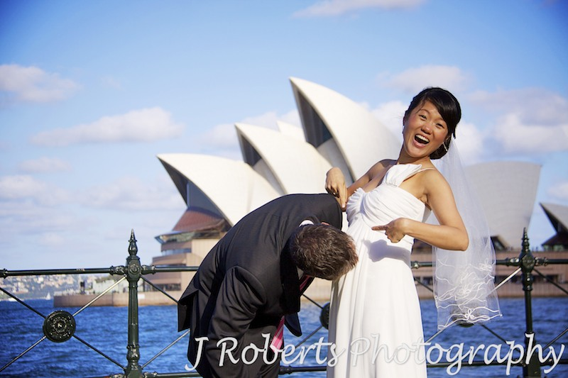Groom kissing pregnant belly - wedding photography sydney