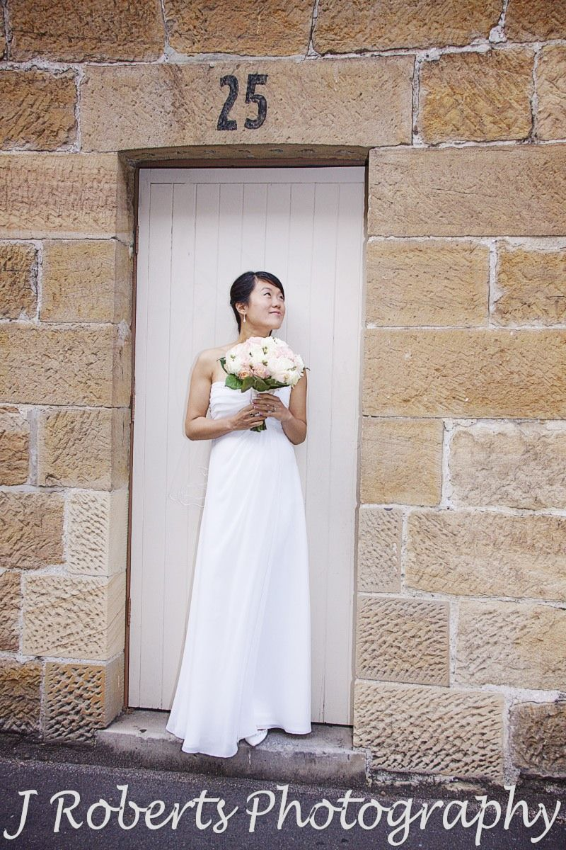 Bride in doorway of sandstone building the rocks sydney - wedding photography sydney