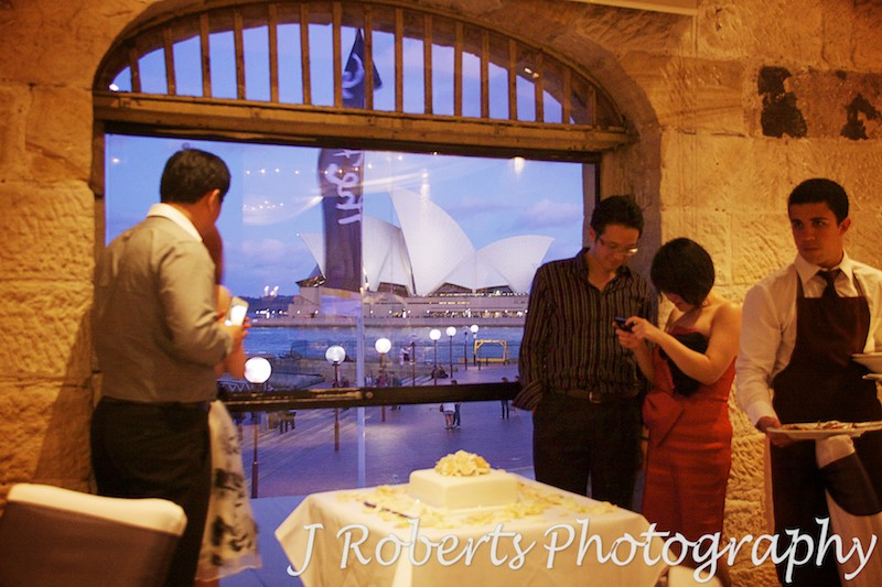 Sydney Opera House at dusk through windows of Wolfies Grill The Rocks Sydney - wedding photography sydney