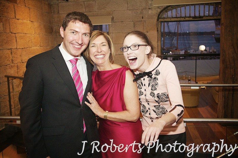 Groom with mother and sister laughing - wedding photography sydney