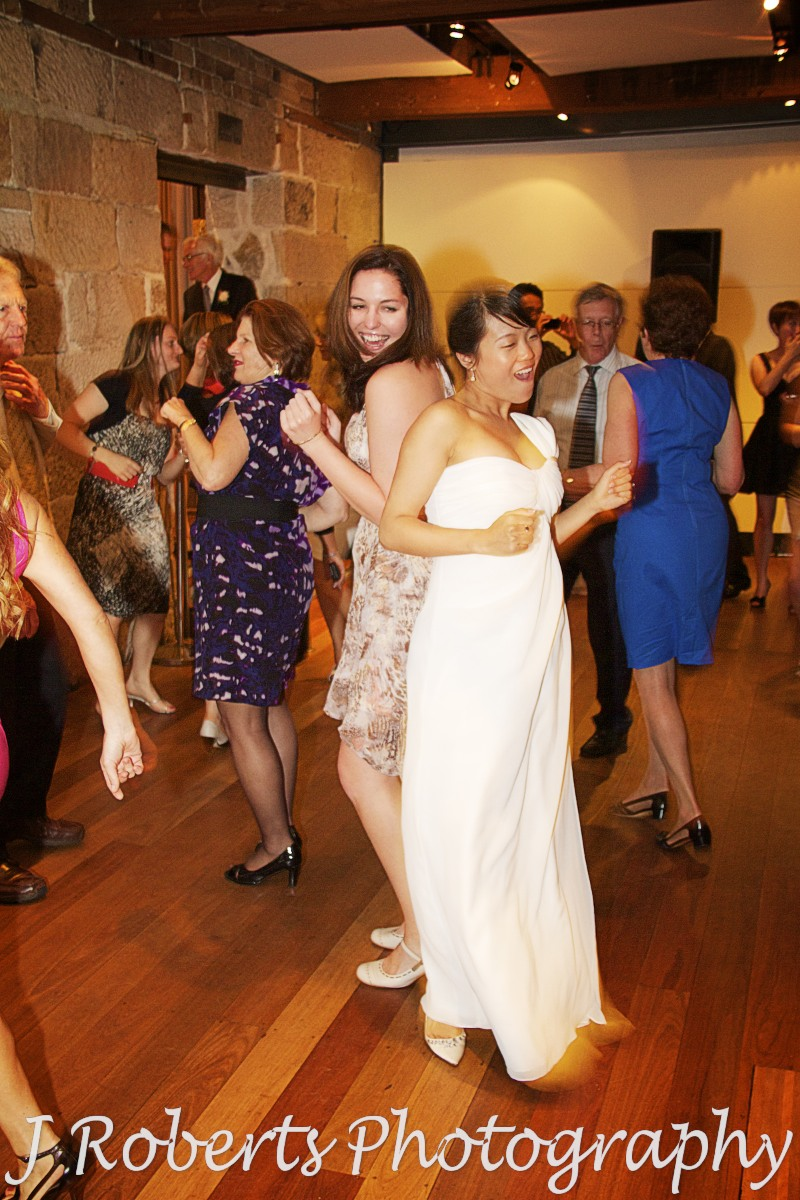 Bride grooving on dancefloor - wedding photography sydney