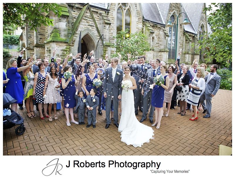 Petals thrown at guests celebrate wedding - sydney wedding photography