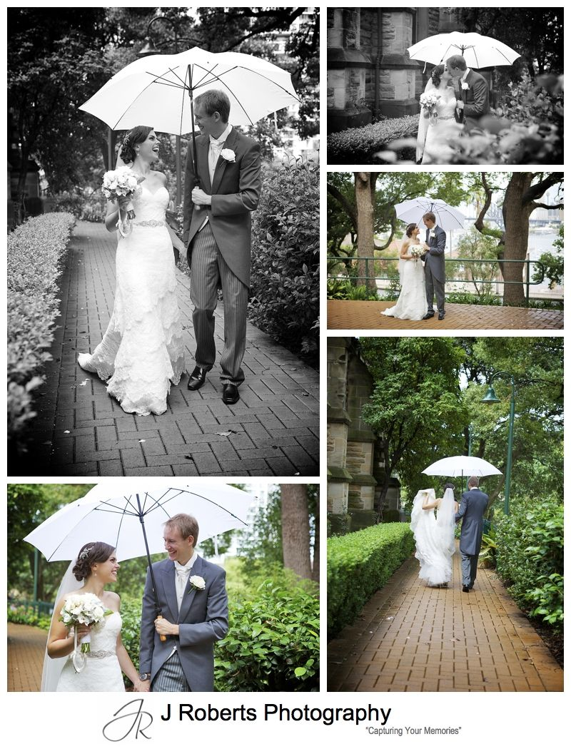 Gorgeous couple with white umbrella in the rain after wedding ceremony - sydney wedding photography