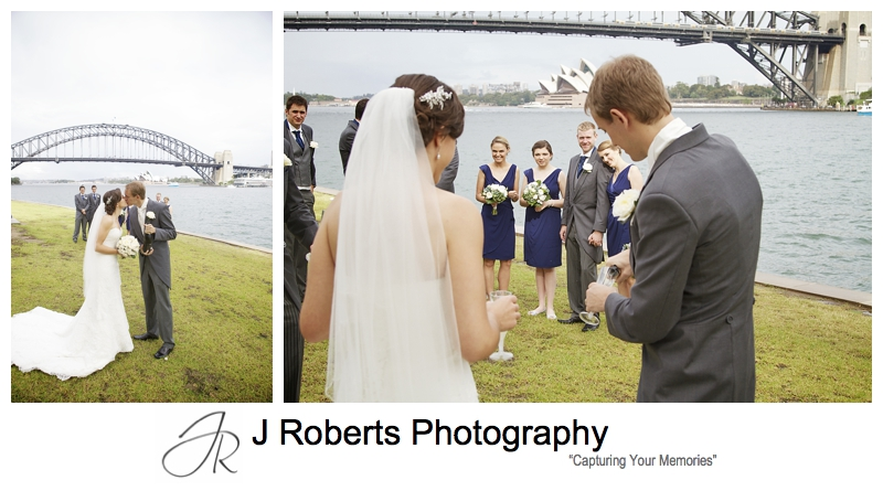 Popping champagne with the bridal party at Blues Point - Sydney wedding photography