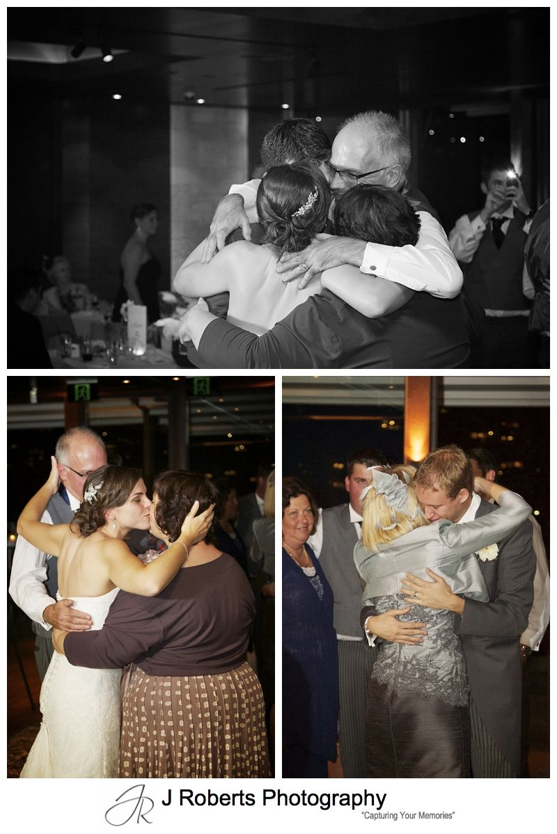 Family hugs during wedding reception - sydney wedding photography