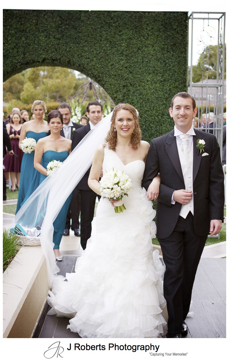 Bride and groom walk down the aisle as the married couple = wedding photography sydney
