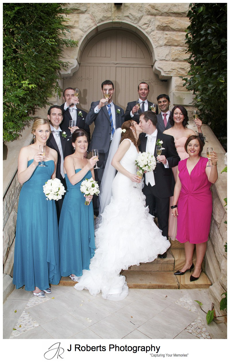Extended bridal party celebrate with champagne - wedding photography sydney