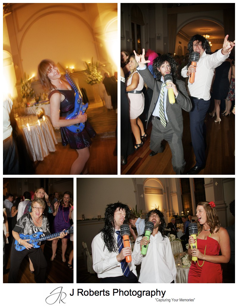 blow up guitars and microphones on dance floor - wedding photography sydney