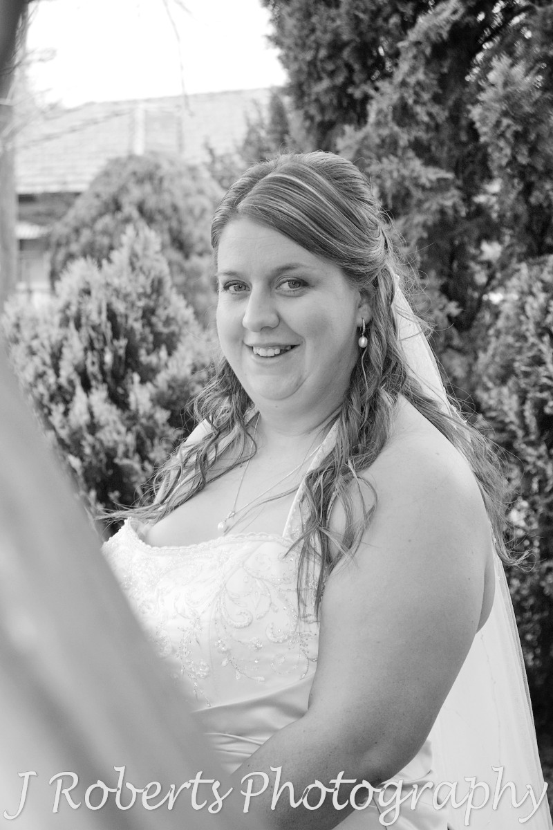 B&W bride smiling at the camera - wedding photography sydney