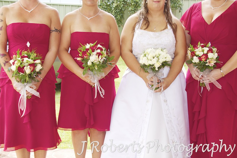 Bride and bridesmaids holding flowers - wedding photography sydney